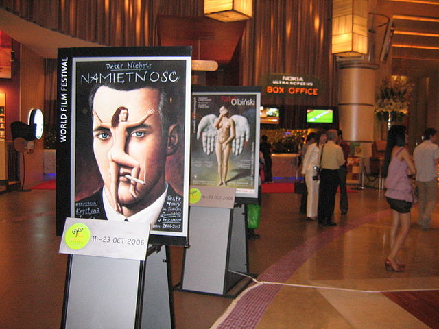 The lobby of Paragon Cineplex at Siam Paragon during the 4th World Film Festival of Bangkok, featuring a poster exhibition by Rafal Olbinski.