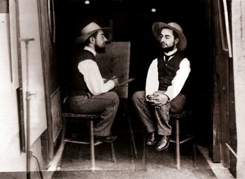 Mr. Toulouse paints Mr. Lautrec in side-by-side sepia photo.